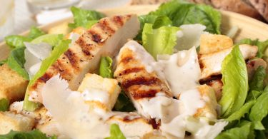 Closeup of griddled chicken caesar salad